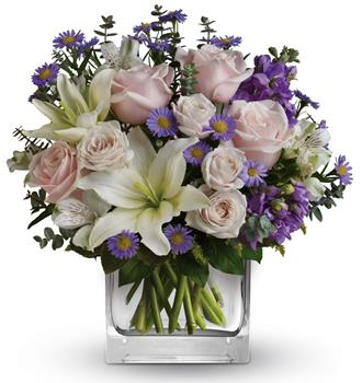 Category: Top 10 for Waitakere online flowers. Code: A58 Name: Watercolour Wishes. Description: Straight off an impressionists canvas, this muted masterpiece is a marvel of pale pink roses and snow white lilies. Price: NZD $84.95 Options: 1. Add Chocolates. 2. Add a Teddy Bear. 3. Add both.
