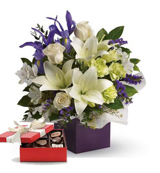 Code: A63. Name: Graceful Beauty. Description: Gorgeous white lilies and delicate blue iris dance gracefully with roses and alstroemeria in this luxurious arrangement. Price: NZD $104.90