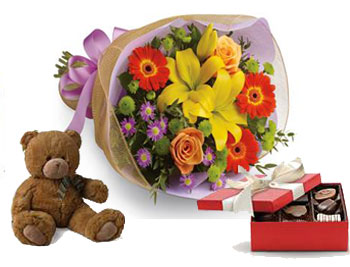 Code: B27CT. Name: Bright Lights with a box of chocolates and a Teddy Bear. Price: NZD $114.90