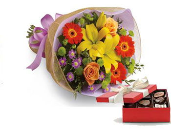 Code: B27. Name: Bright Lights. Description: A burst of brilliant flowers designed to make their spirits soar! This spectacularly colourful bouquet includes lilies, gerberas and roses. Price: NZD $109.90