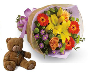 Code: B27. Name: Bright Lights. Description: A burst of brilliant flowers designed to make their spirits soar! This spectacularly colourful bouquet includes lilies, gerberas and roses. Price: NZD $99.90
