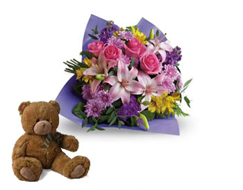 Code: B33. Name: Love and Laughter. Description: Contemporary yet classic, this bouquet includes an elegant mix of roses, lilies and alstroemeria. Price: NZD $129.90