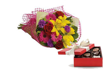 Code: B38. Name: Fun in the Sun. Description: Let the sun shine in with this exuberant bouquet of golden lilies, rich red roses and hot pink gerberas. Price: NZD $104.90