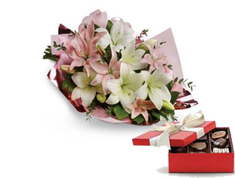 Code: B40. Name: Lovely Lilies. Description: Stunning in its simplicity, this innocent harmony of light pink roses and snow white lilies are a heartfelt way to send your very best. Price: NZD $109.90