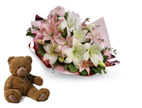 Code: B40. Name: Lovely Lilies. Description: Stunning in its simplicity, this innocent harmony of light pink roses and snow white lilies are a heartfelt way to send your very best. Price: NZD $99.90