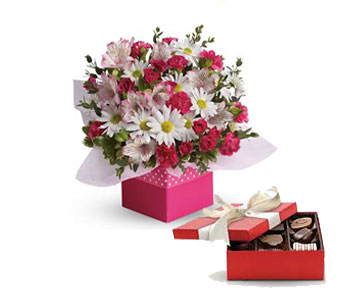 Code: C22. Name: Polka Dot. Description: Polka dots and posies, they are the perfect pair. Well, at least in this pretty arrangement they are. Price: NZD $112.90